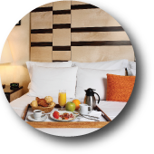 Image of Capital Bedding's Hospitality Line Logo. The logo contains a picture of a hotel room bed.